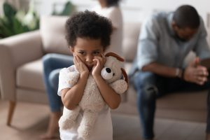 boy closed ears not to hear parents arguing